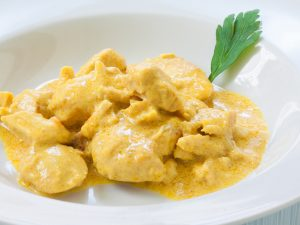 chicken curry with boiled rice and spices